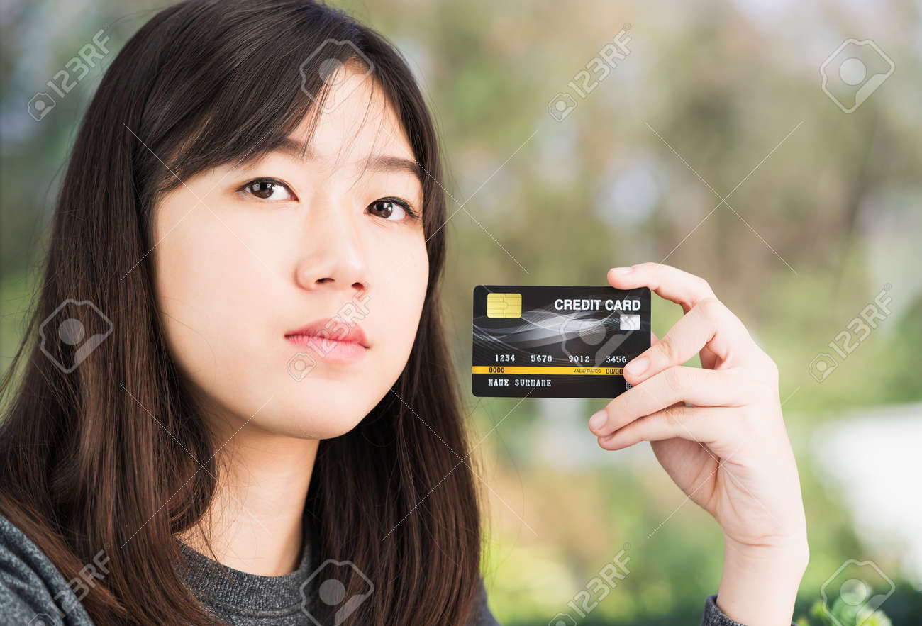Close up young woman holding credit card. Online shopping concept - 140754983