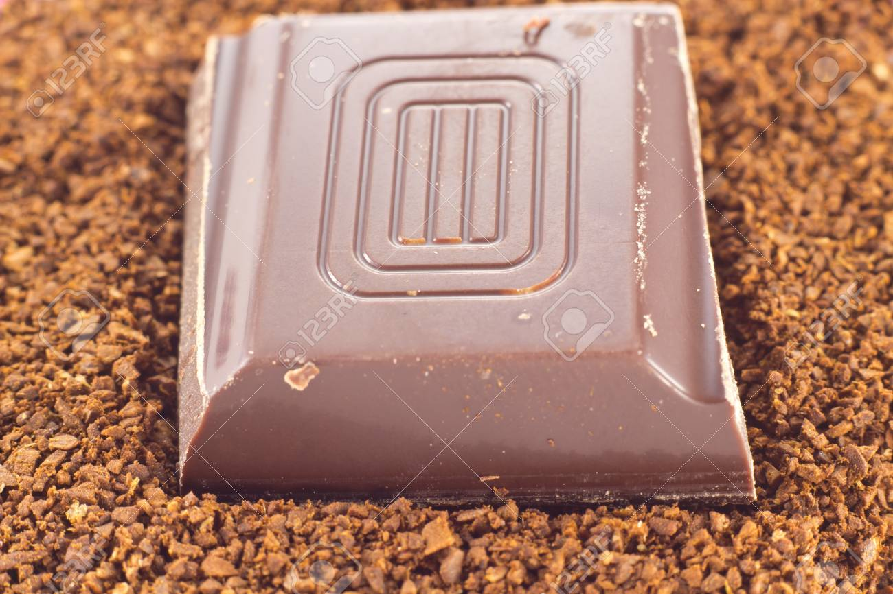 Picture of a chocolate piece on cofee powder Stock Photo - 13405937