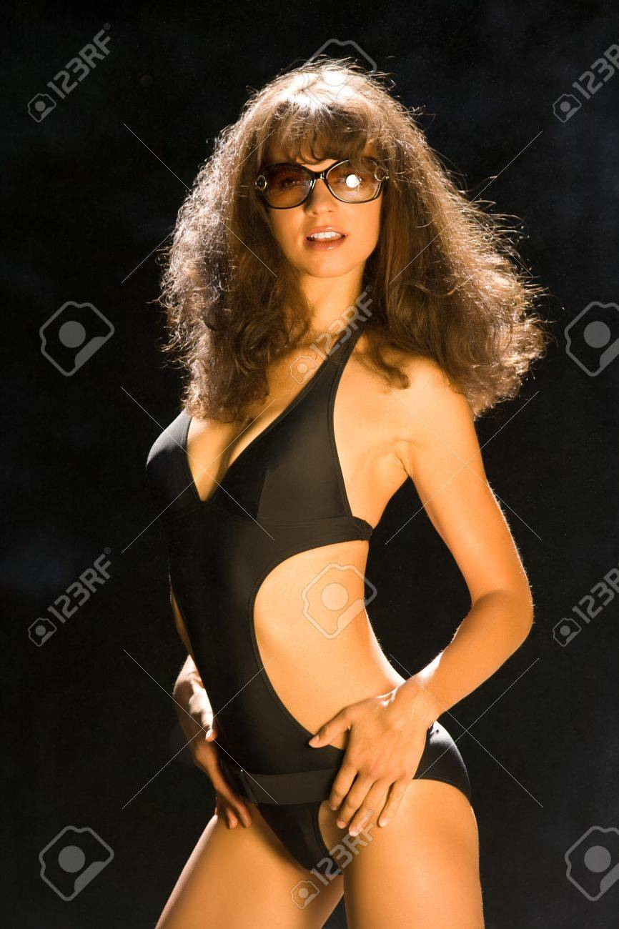 Young girl in a very nice black swimsuit Stock Photo - 10502141