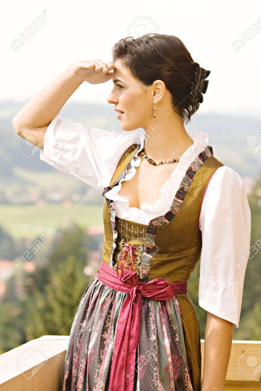 Bavarian girl in Holiday costume sitting on a bench Stock Photo - 10487086