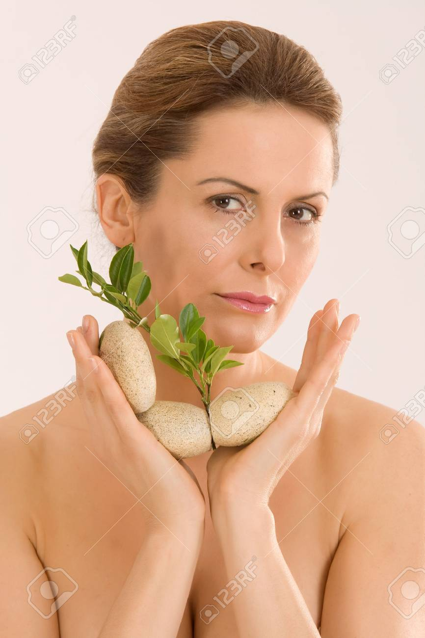 young woman with an aromatherapy with herbs and stones Stock Photo - 12943299