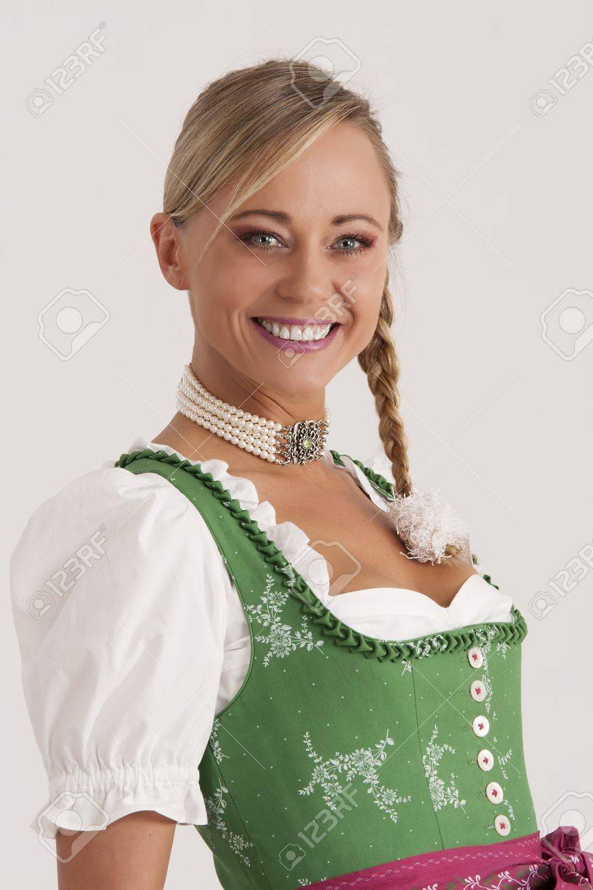 Portrait of a girl in the green Bavarian dirndl Stock Photo - 13268672