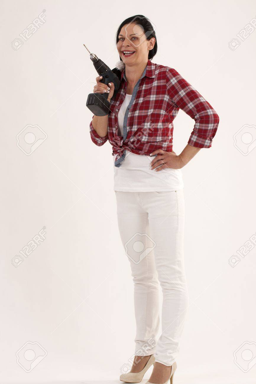 The modern woman and her drill Stock Photo - 13741304