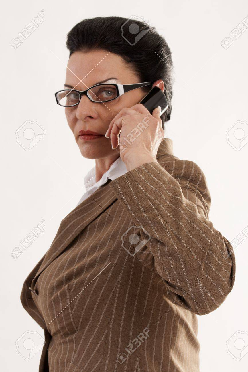 Elegant business woman with fashionable glasses when phoning Stock Photo - 13741365