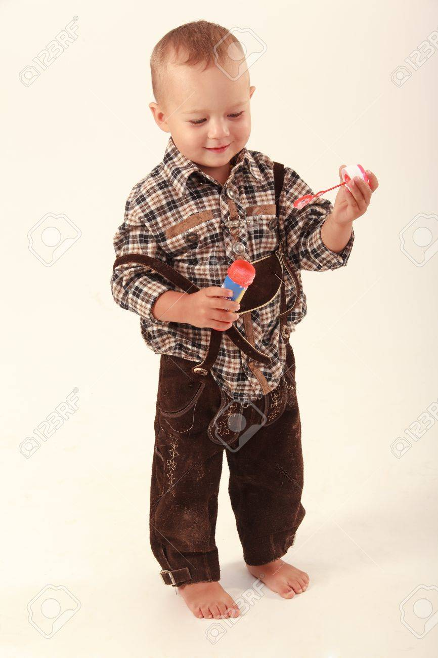 Bavarian boy in leather pants playing with soap bubbles Stock Photo - 15389235
