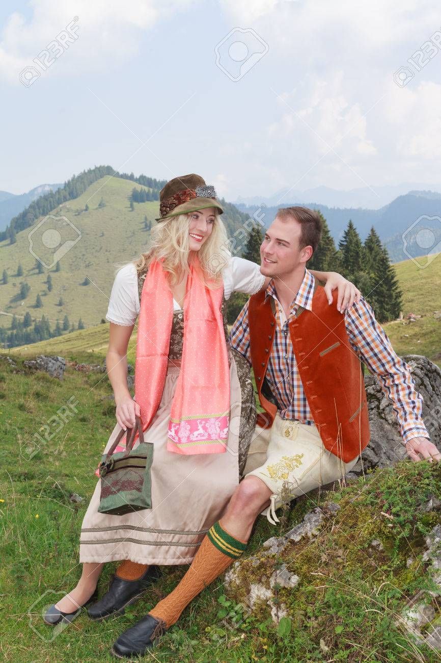 Bavarian couple in love in fashionable clothing traditional costume in the mountains Stock Photo - 32275923  sc 1 st  123RF.com & Bavarian Couple In Love In Fashionable Clothing Traditional Costume ...