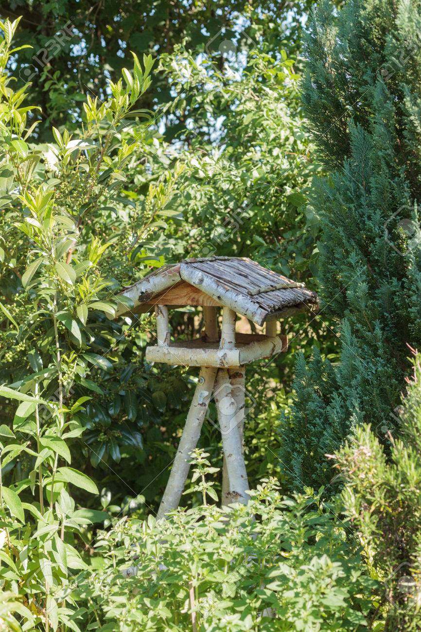 Rustic Three Legged Wooden Bird Table Made From Tree Branches