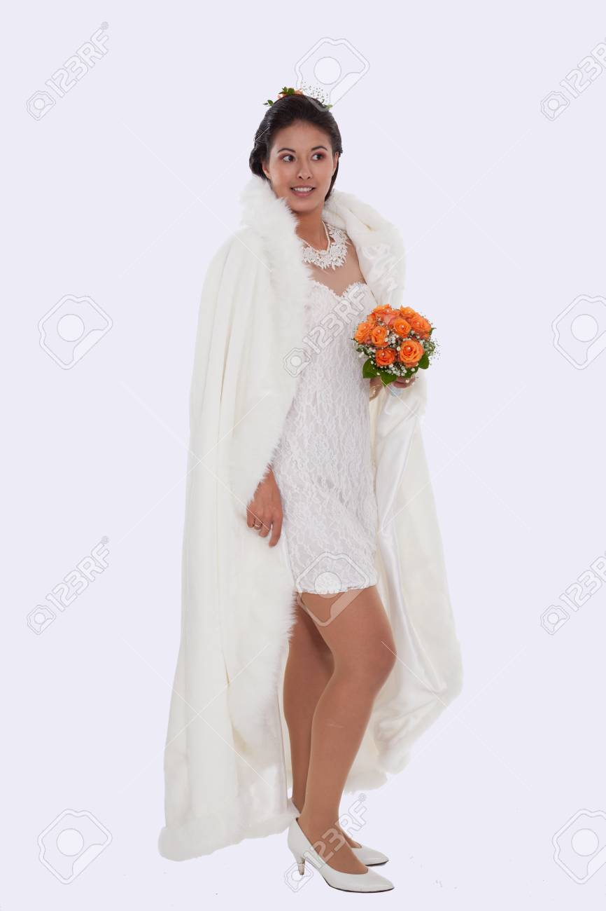 Young Bride In Short Dress With White Cape And Bridal Bouquet