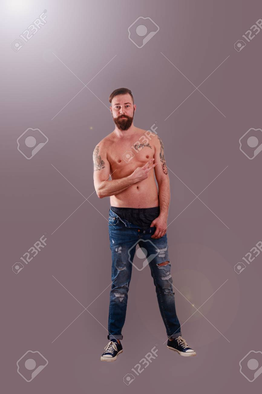 Bearded Man With Bare Muscular Upper Body And Tattoos Stock Photo