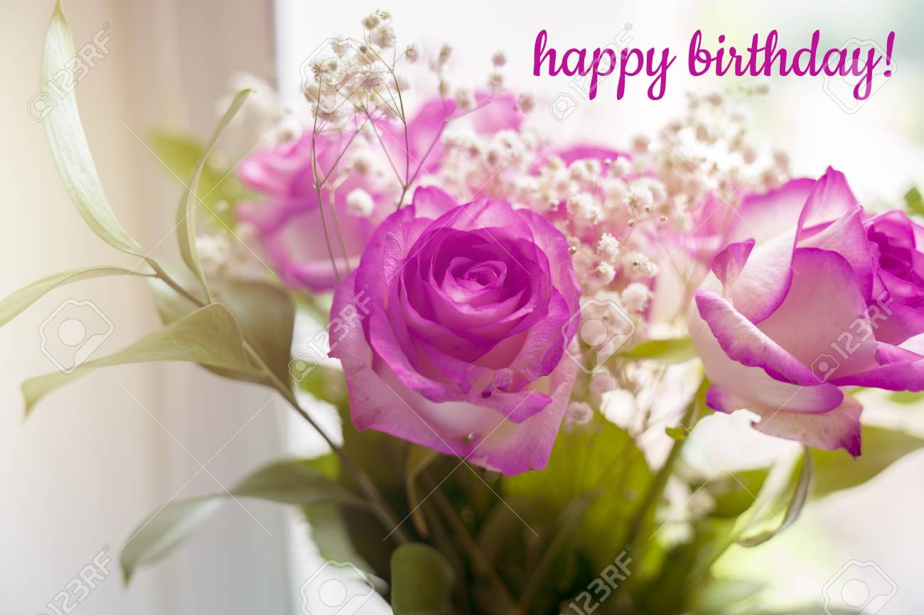 Beautiful Bouquet Of Roses On A Window With The Text Happy Birthday Stock Photo