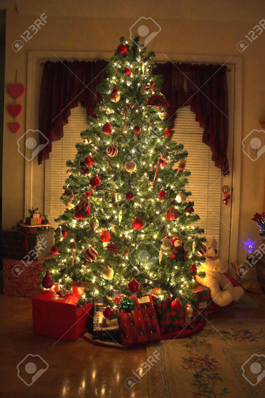 home with lighted christmas tree presents stock photo 505550 - Lighted Christmas Presents