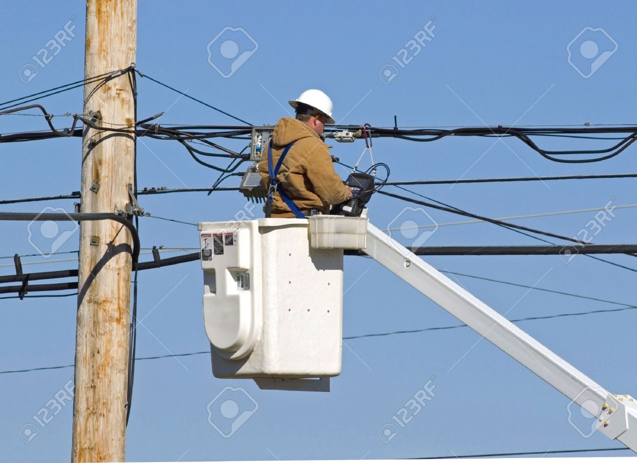 Cable Technician Working On Communication Lines By Using Bucket ...
