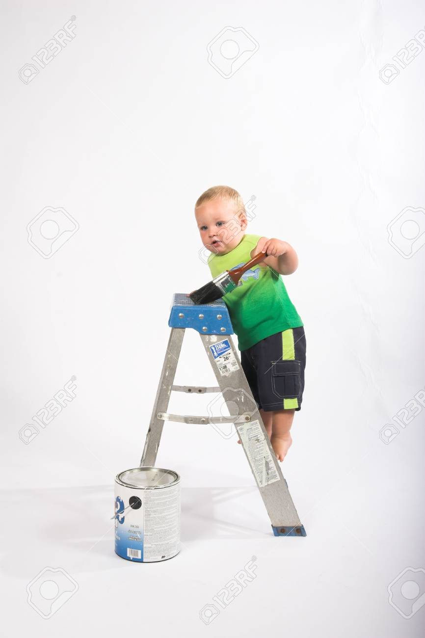 boy trying  to paint a ladder that he is climbing on (isolated) Stock Photo - 710130