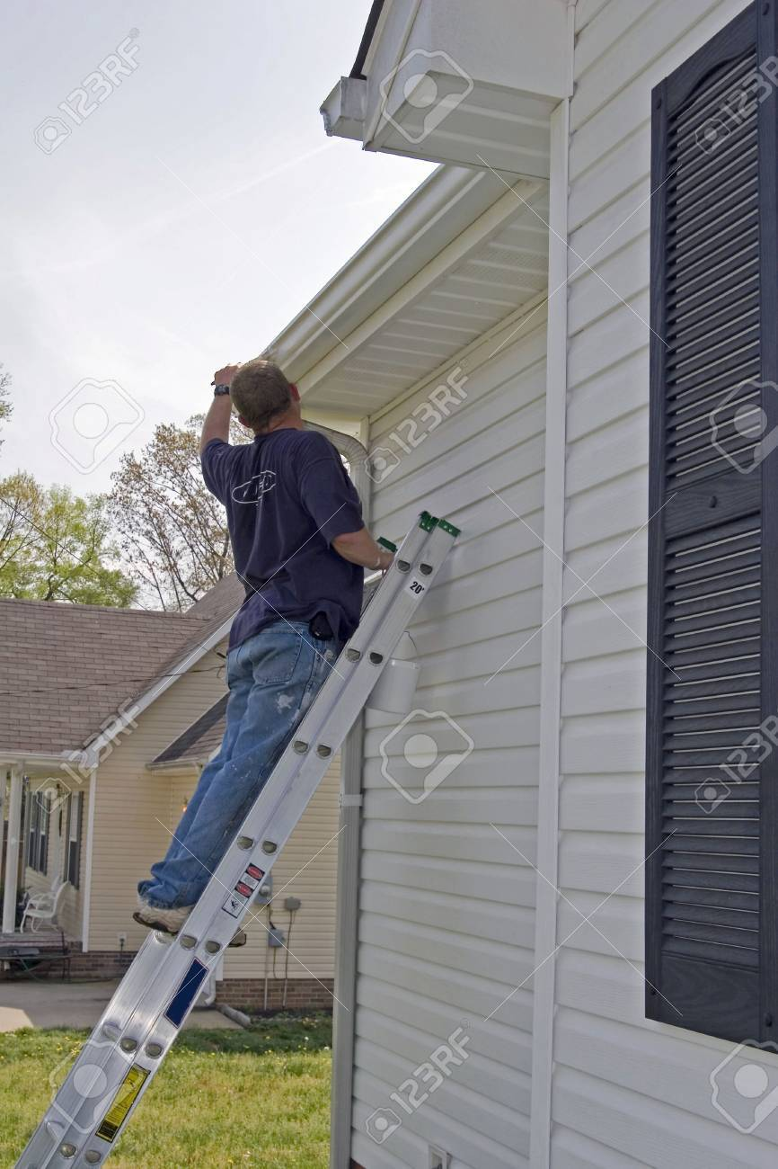 Local contractor painting outside of house, business is booming in summer months Stock Photo - 870133