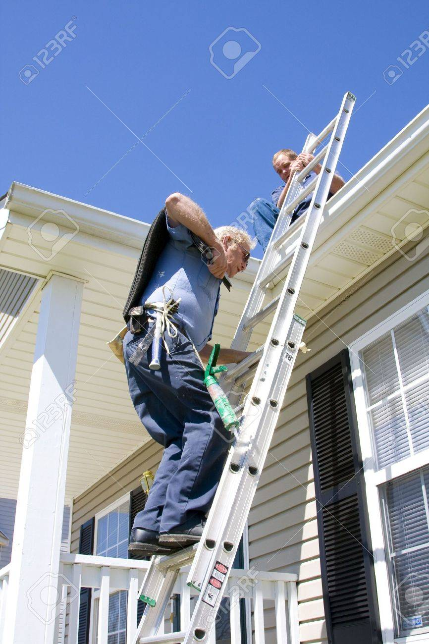 oofing contractor repairing damaged roof on home Stock Photo - 2743770