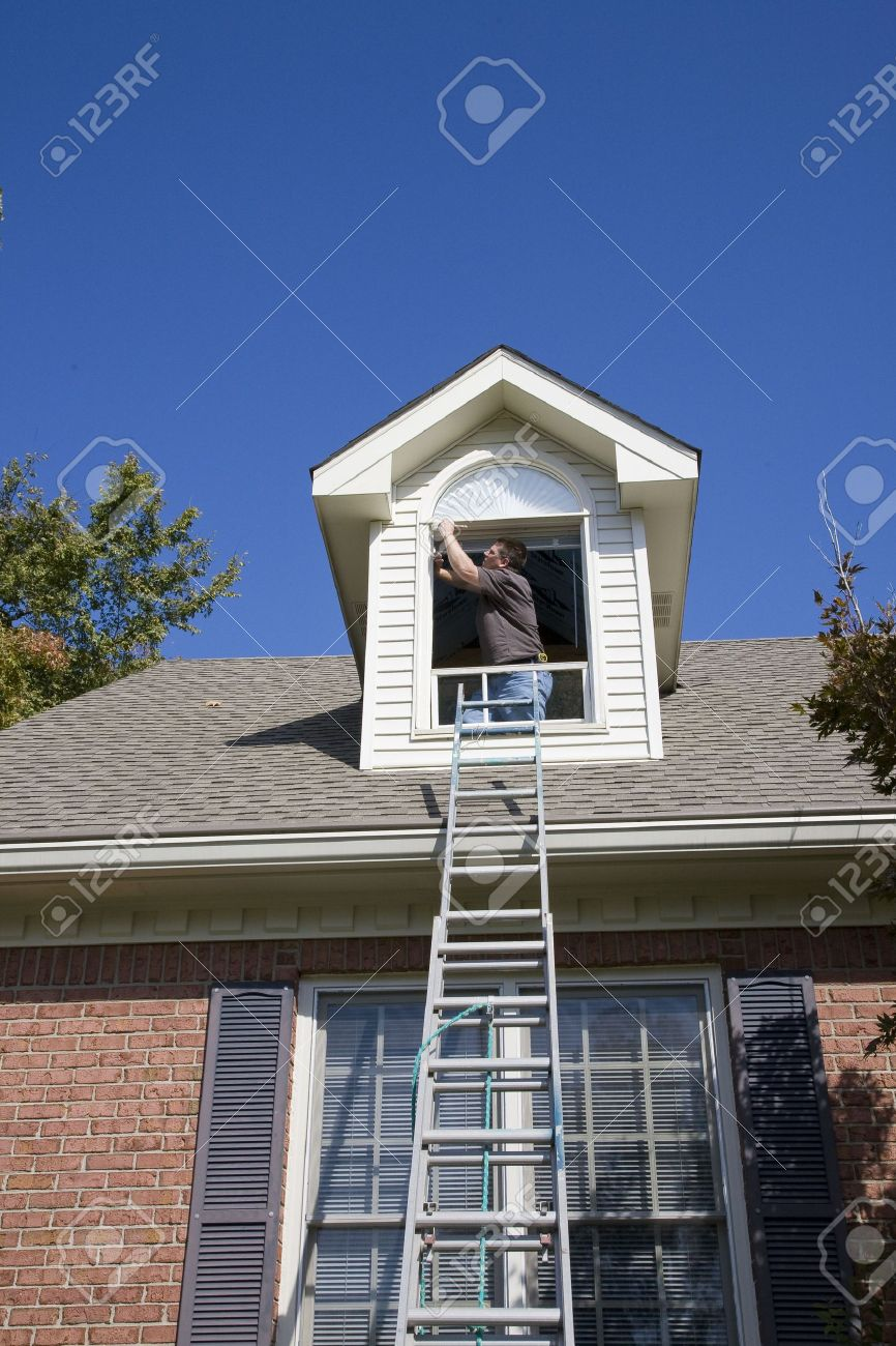 Contract painter painting exterior trim to speed up selling of