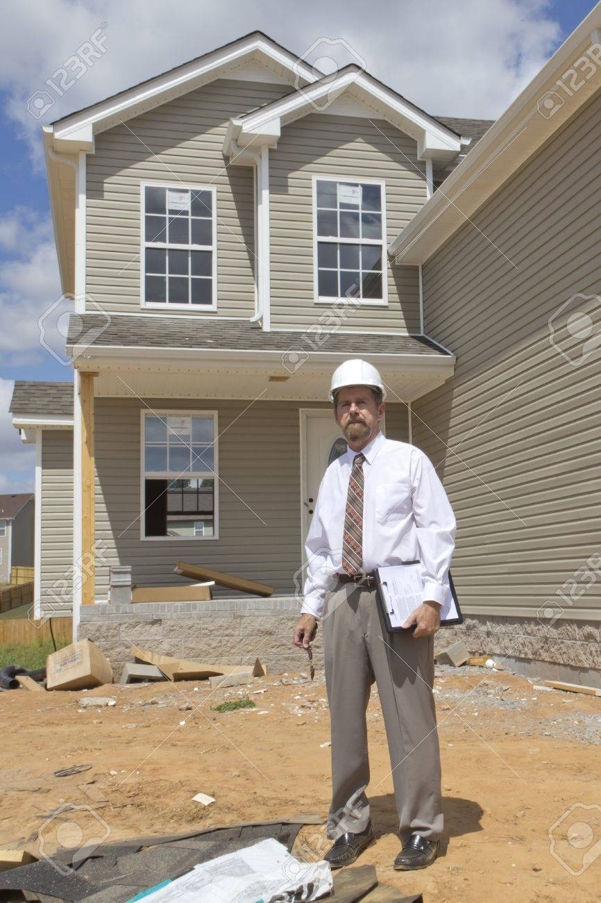 Bank finance personal inspecting new home, his company financed the builder Stock Photo - 10361014