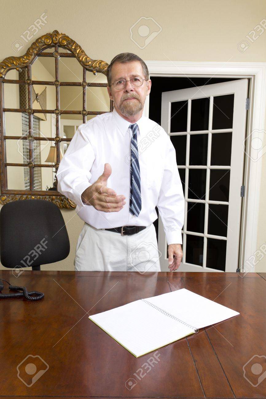 Loan officer at local bank is going to interview business man to better understand his needs Stock Photo - 10633459
