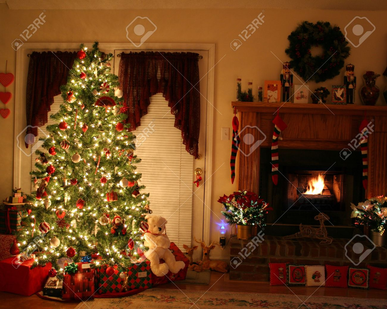 home with lighted christmas tree presents fireplace stockings