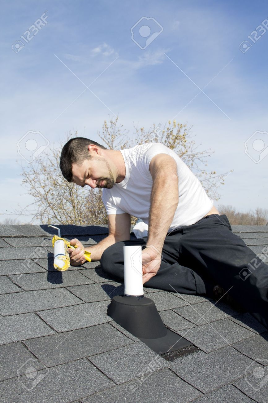 Roof Leaking Around Vent roofer repairing leaks around vent pipes on home roof, water