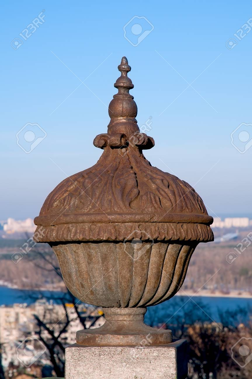Vintage metal sculpture on a stone base on the background of blue sky. Stock Photo - 18824793