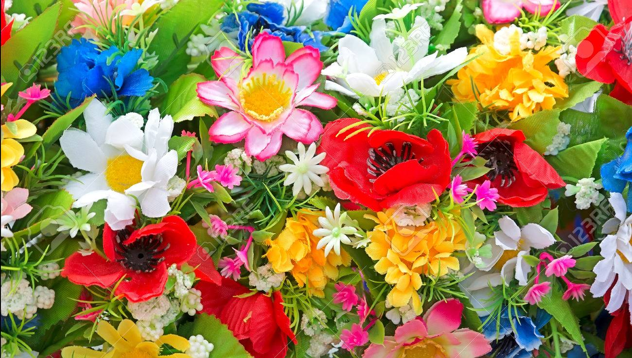 Background of bright colorful artificial flowers close up stock background of bright colorful artificial flowers close up stock photo 30121041 mightylinksfo