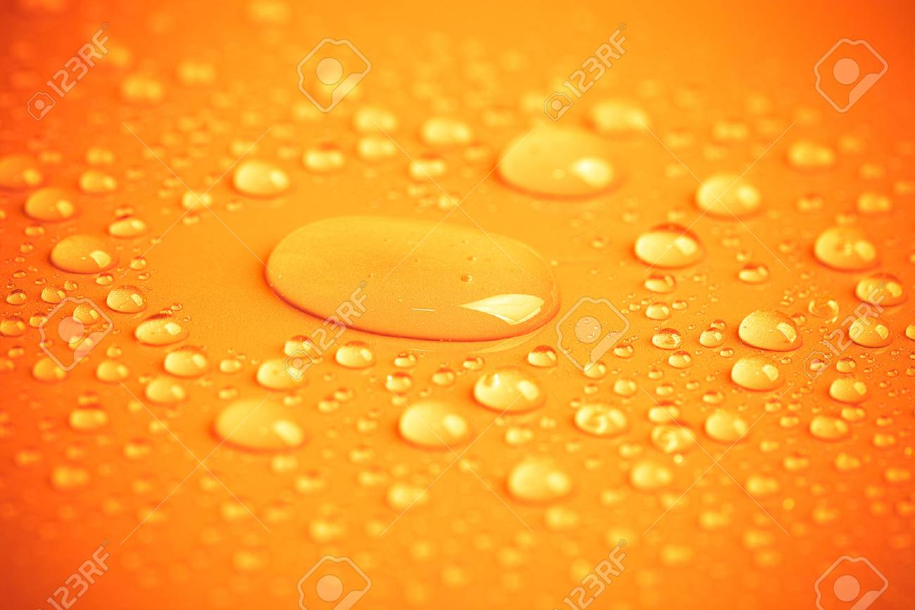 Drops of water on a color background. Toned yellow. Shallow depth of field. background - 40192843