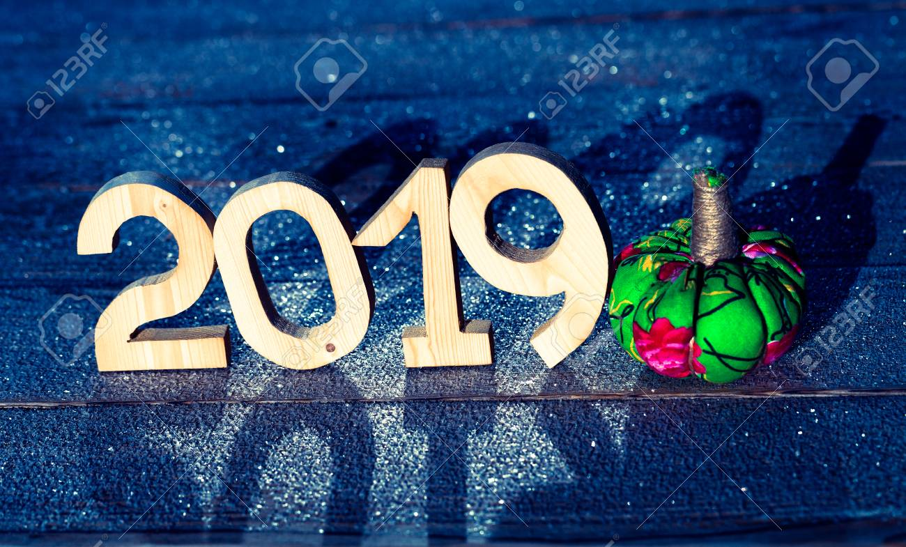 stock photo wooden figures 2019 on a wooden frozen background happy new year
