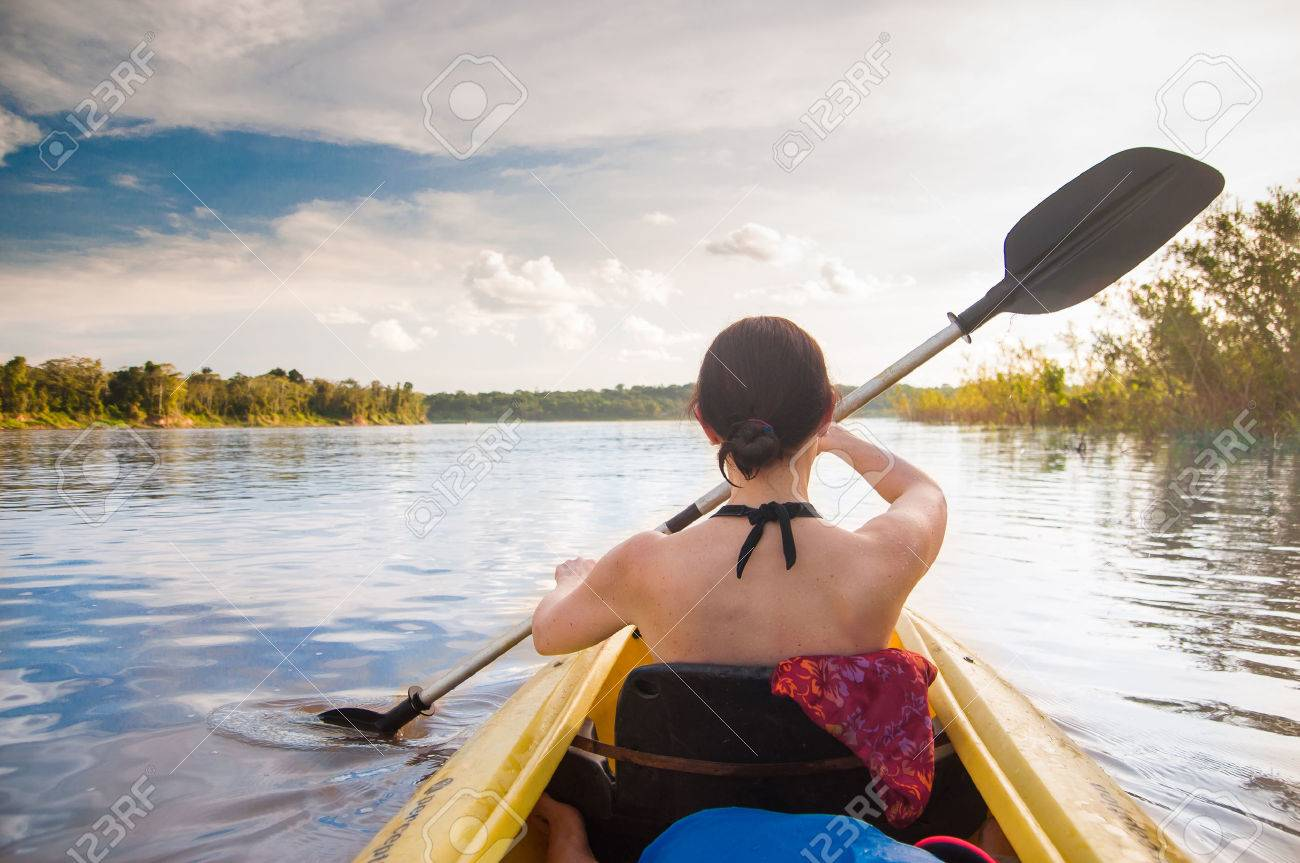 view on woman with kayak on the Amazon - 75705039