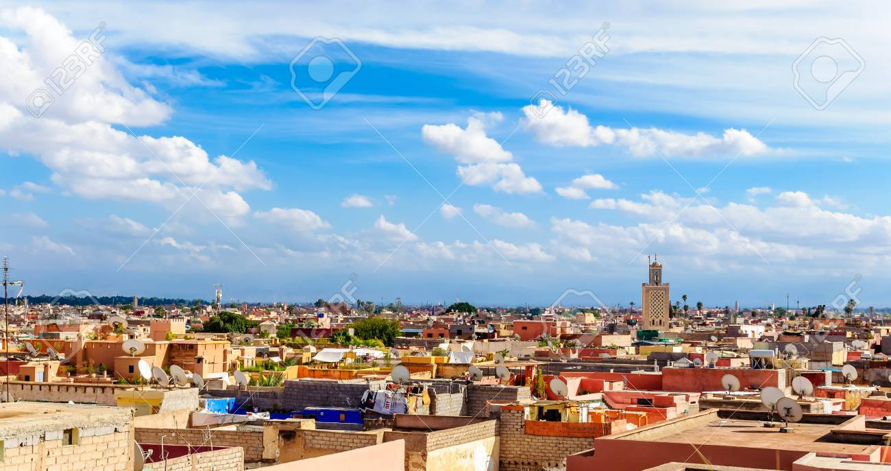 View over the colorful roofs over Marrakesh - 77879566