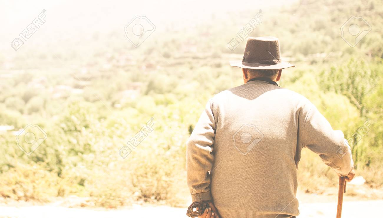 View on Old man in summer landscape - 83184581