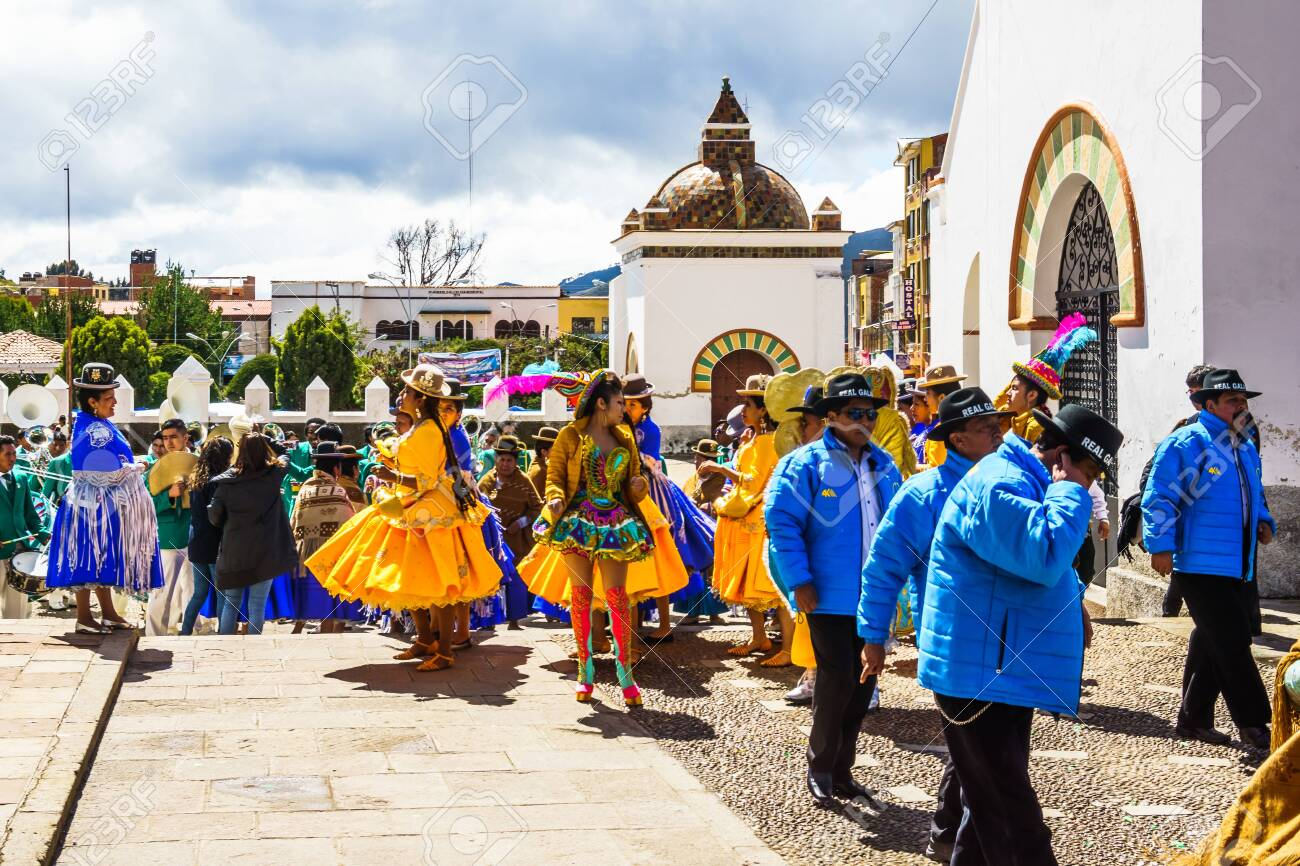 Cocacabana, Bolivia 30th April 2017: View on group of local people celebrating parade and playing drum and woman in dress dancing - 142308230