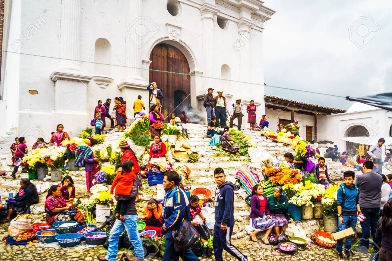 Chichicastenango, Guatemala on 2th May 2016: View on group of indigenous people selling products in front of church - 142308253