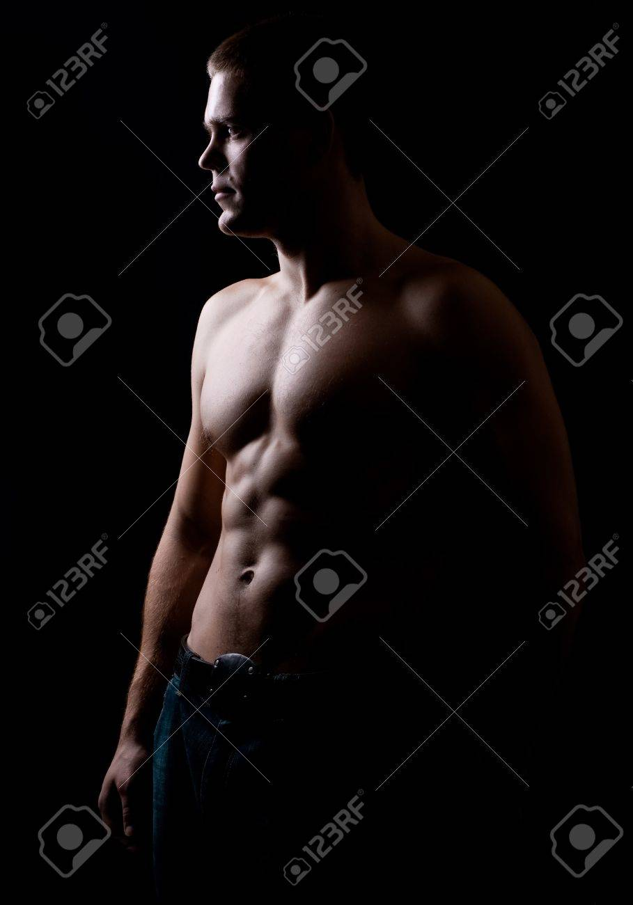 strong athletic man on black background Stock Photo - 8261108