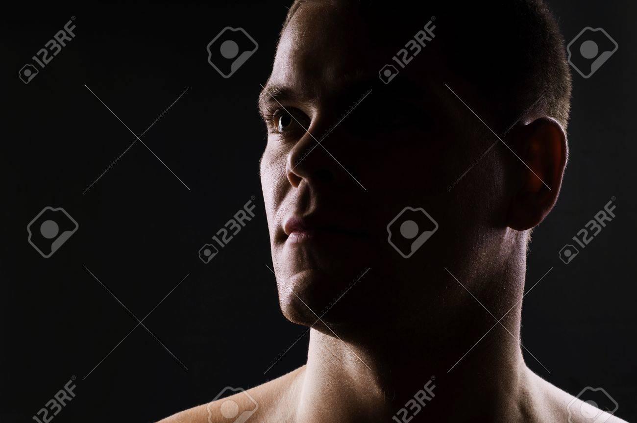 Man s portrait on black background  Close-up face Stock Photo - 13304491