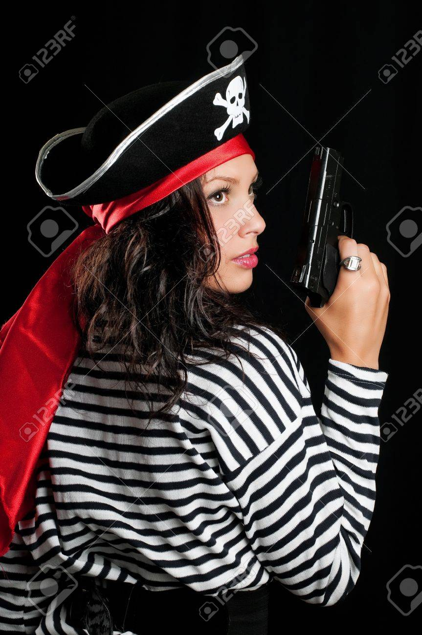 Young woman dressed as a pirate in a black hat holding an gun Stock Photo - 13304524
