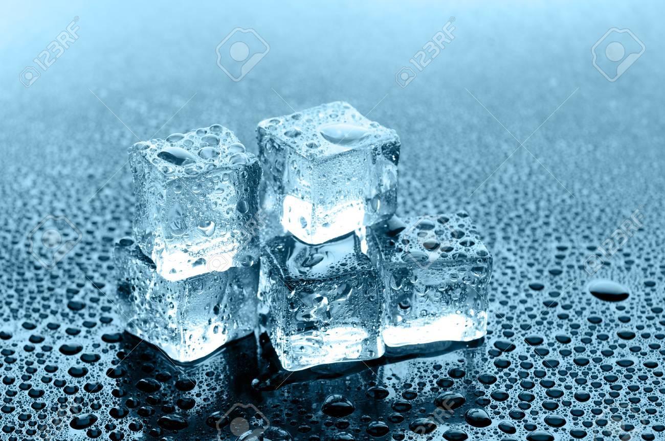 wet ice cubes on black glossy background Stock Photo - 12815821