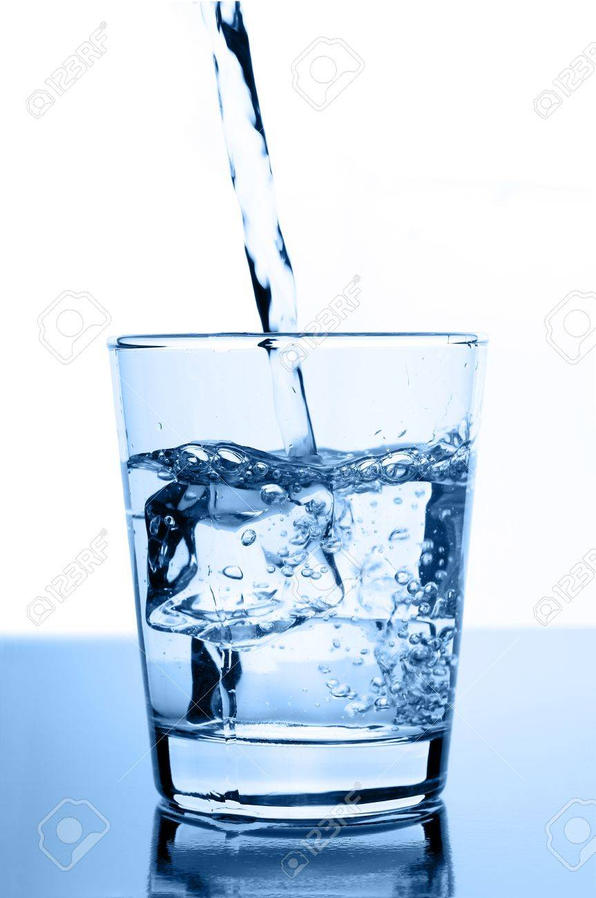 water pouring in to glass with ice cubes on glossy background Stock Photo - 12815686