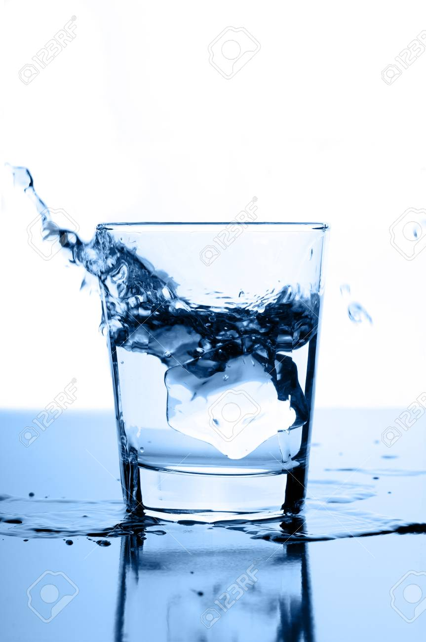 water splash in glass with ice Stock Photo - 12815657