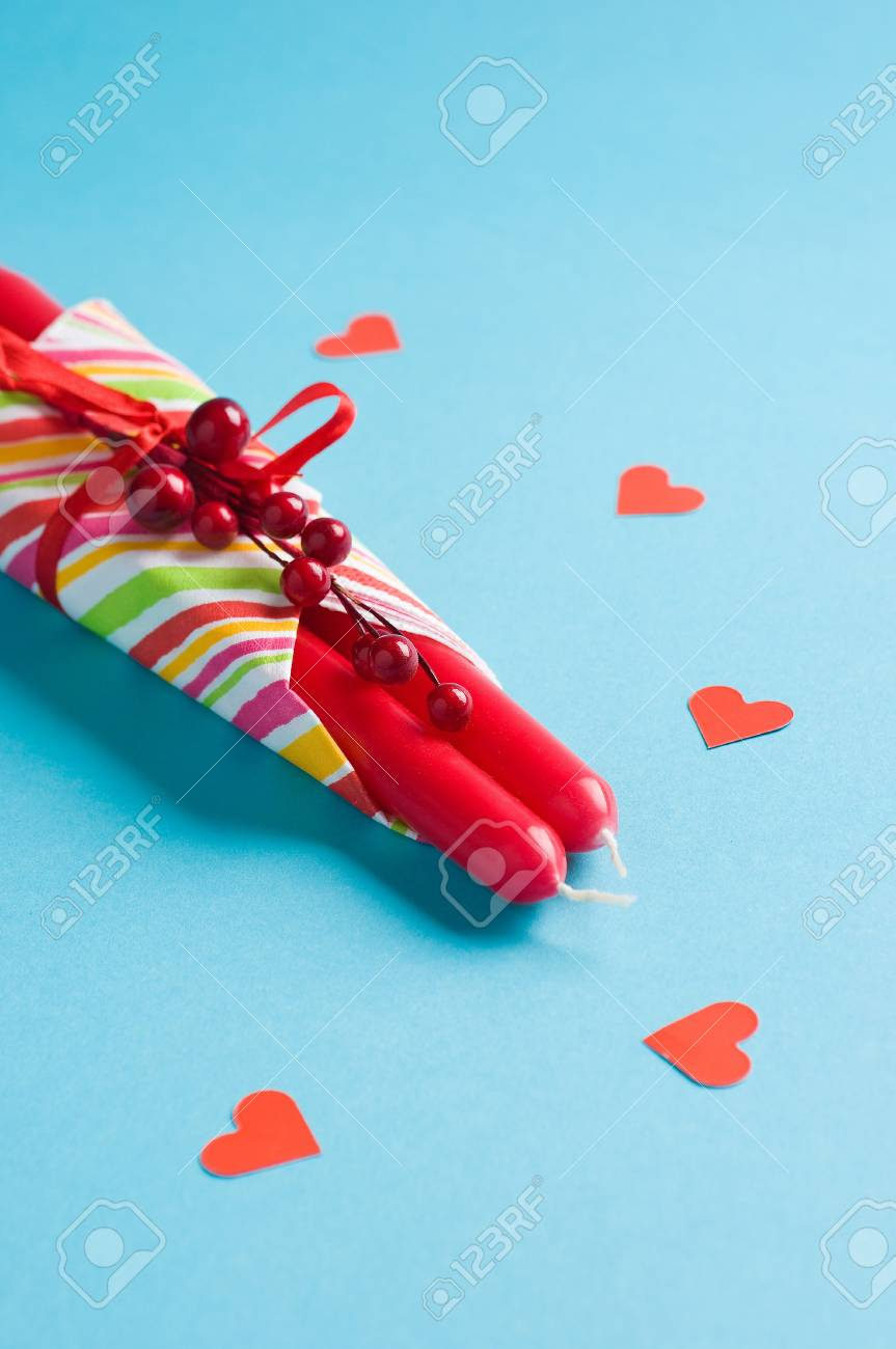 red candles and hearts on blue Stock Photo - 12815790