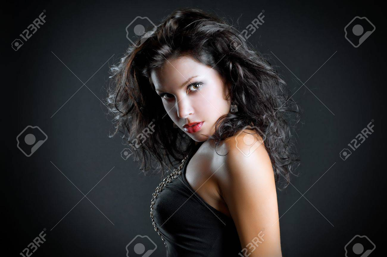 art fashion photo of portrait young woman on dark background Stock Photo - 13304525