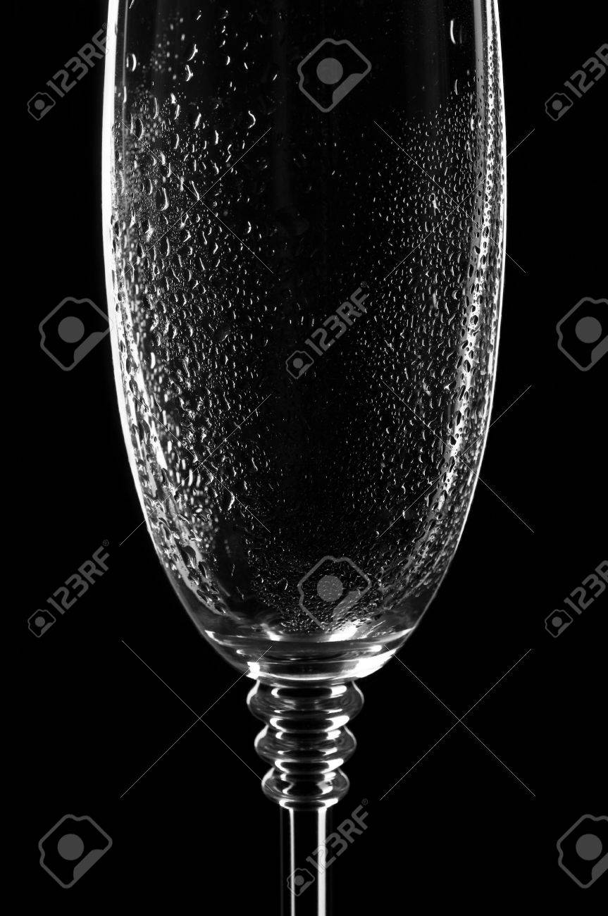 Still-life  wet and clear wine glass on black Stock Photo - 17247810