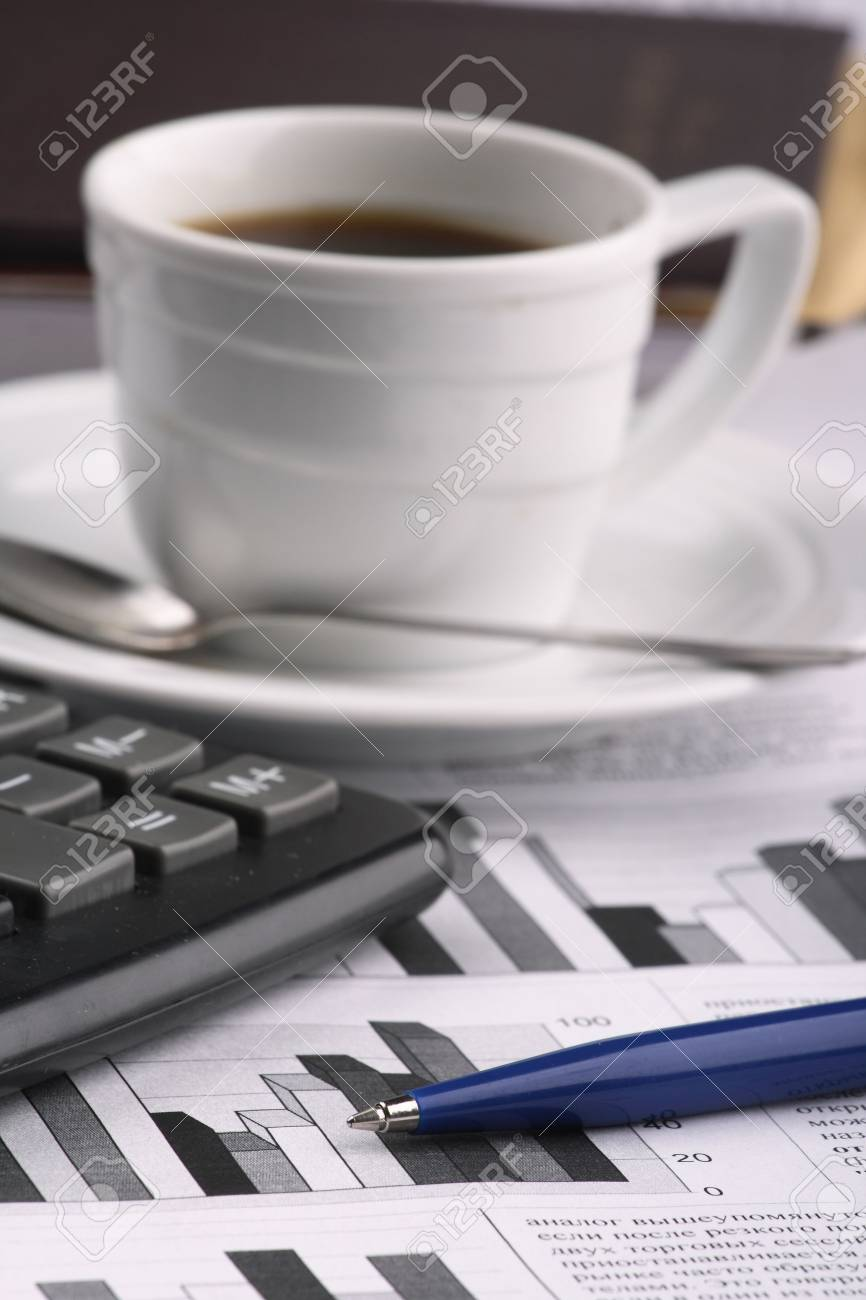 Cup of fragrant coffee on a morning paper business news Stock Photo - 2513033