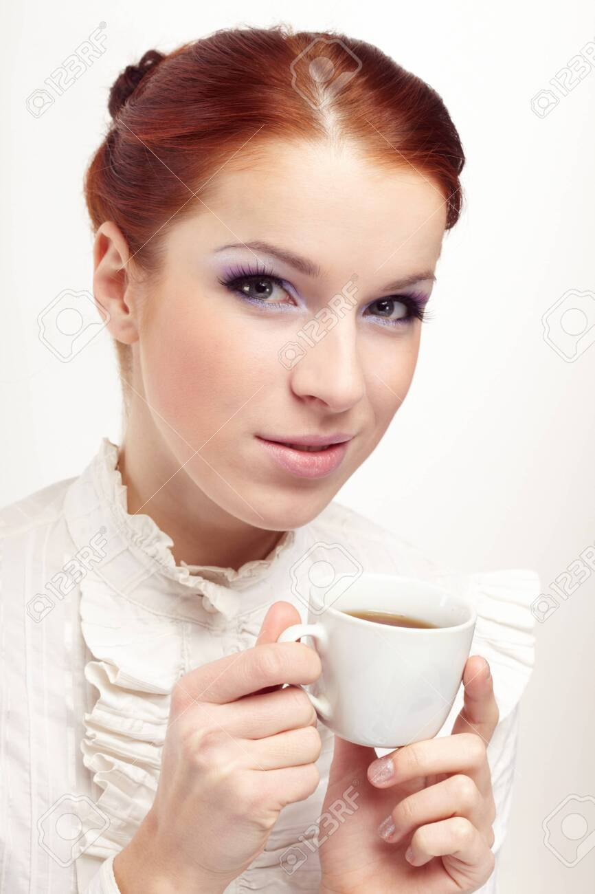 Business woman holding cup of coffee. Stock Photo - 7064036