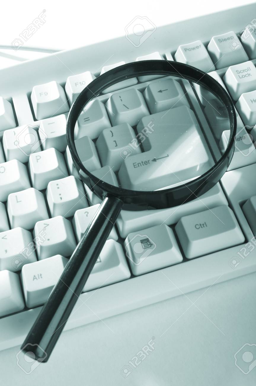 Magnifying glass, button, key Stock Photo - 7900636