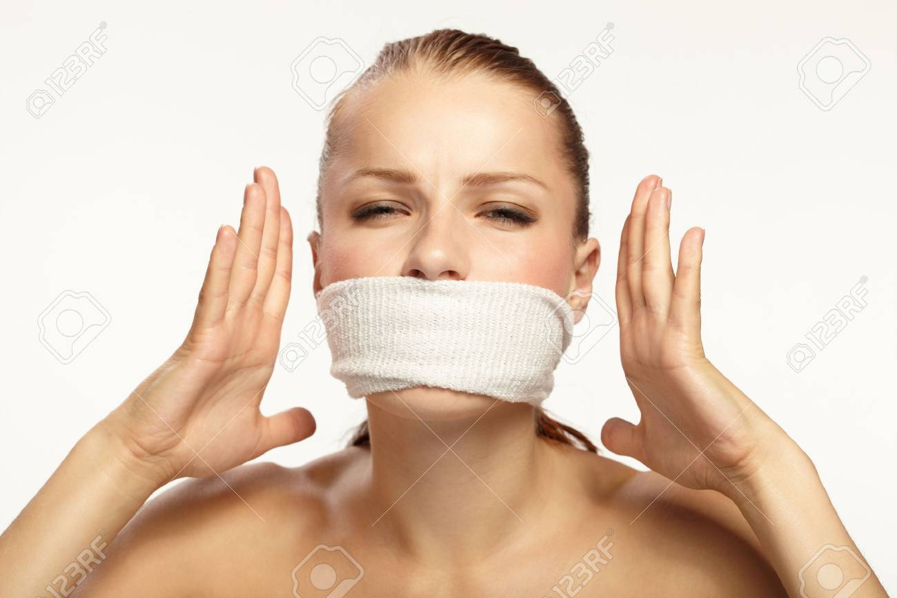 Cute young woman with white band on the mouth Stock Photo - 9511767