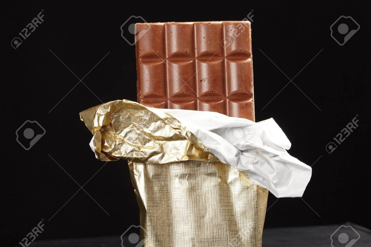 chocolate in bar with open gold cover. Stock Photo - 9652886