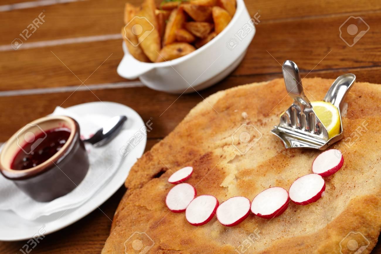 schnitzel with roasted potatoes Stock Photo - 13254593
