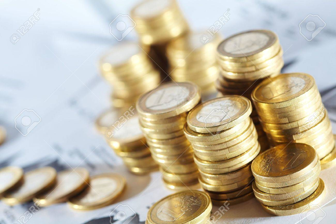 Business diagram on financial report with coins Stock Photo - 14172696