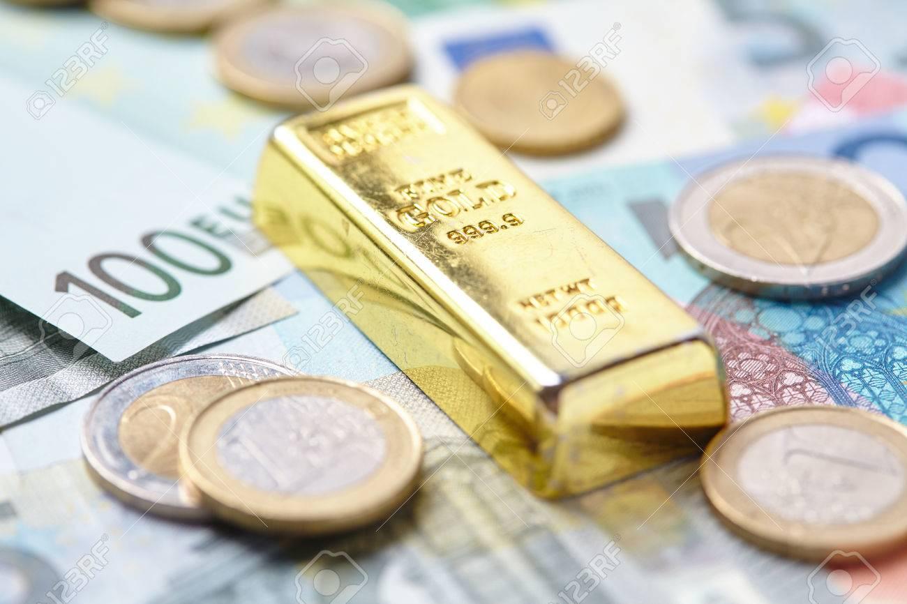 Gold Bar On Money Stock Photo